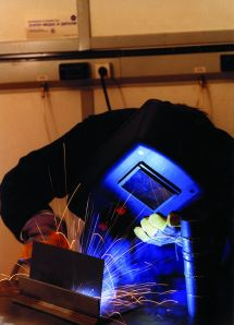 Person Welding Using Eye Protection